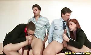 Cum-loving streetwalkers kneeling down and taking gigantic dicks in their mouths