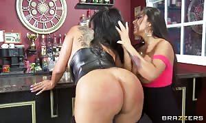 Kiara Mia and Nina Mercedez licking in a bar