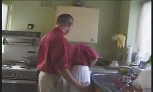 blond English beauty penetrated in the kitchen