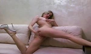 extraordinary blond is gulping a tasty pink fake cock in the bed