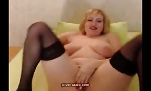 Big-breasted French milf is spreading her long stems