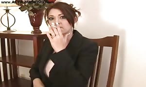 female domme is smoking her long cigarette so freaking sexy