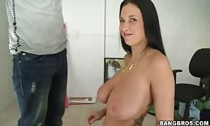 heavy chested Bella Blaze does tug job in close up