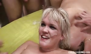 blond is swallowing juicy a lot of aroused jizz in the gang-fuck video