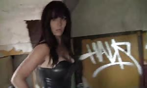 spandex suit looks horny on this dark-haired prostitute with giant funbags and strap-on dildo sex toy