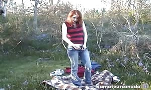 red-head teenager jacks off her vagina on the grass